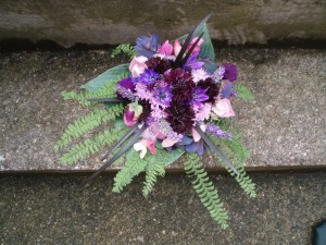 small pink, black & blue bouquet